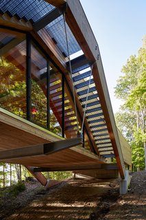 A Unique Home in the Canadian Forest That Doubles As a Bridge - Photo 2 of 11 -