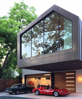 This Austin Home Was Designed to Showcase a Vintage Car Collection - Photo 1 of 20 -