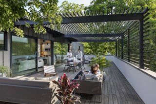 Dwell's Top 10 Outdoor Spaces of 2017 - Photo 5 of 10 - Austin-based firm Matt Fajkus Architecture designs a two-level garage and residence with a ground-floor space that was built to showcase the owner's prized collection. Set on a 10,300-square-foot narrow lot in Austin, Texas, the Autohaus was created to devise a fully functional gallery-like space. With automobile upkeep and display as the starting point, Matt Fajkus Architecture designed an asymmetrical home that's set on a rectangular base with a 20-foot cantilevered second floor to house the living space.