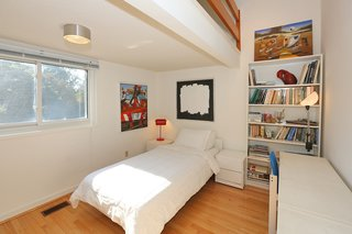 An Airy Toronto Estate For Sale Boasts Excellent Feng Shui - Photo 8 of 13 - The third bedroom features a mezzanine level perfect for a children's play space.