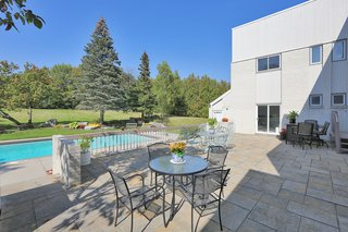 An Airy Toronto Estate For Sale Boasts Excellent Feng Shui - Photo 10 of 13 - A 30' x 40' patio leads to 20' x 40' in-ground concrete swimming pool.