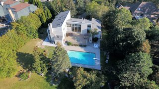 An Airy Toronto Estate For Sale Boasts Excellent Feng Shui - Photo 12 of 13 - The swimming pool area is thoughtfully landscaped with large rocks interspersed with blue spruce, green spruce, pines, maples and oak trees.