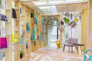 """This New Urban Cabin May Be Our Best Solution for City Living - Photo 2 of 7 - The central volume of the home is occupied by a """"library"""" featuring books which can be retrieved randomly by pulling on the ropes which hang from the ceiling."""