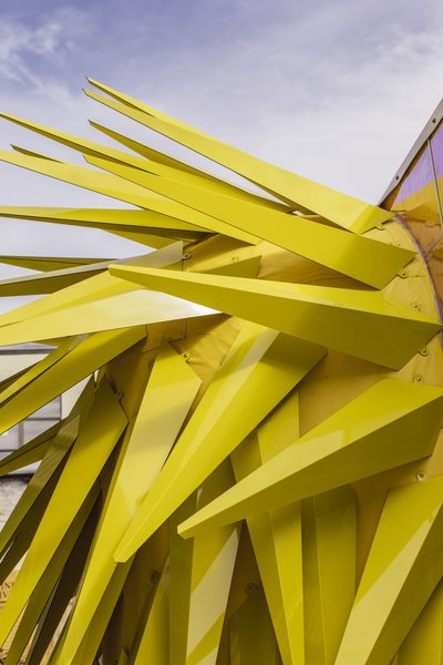 MINI LIVING always makes an effort to work together with local designers on their projects and the bright yellow metal spikes on the exterior were created by the MINI LIVING design team's NYC-based collaborators Bureau V— injecting an element of surprise into the design.