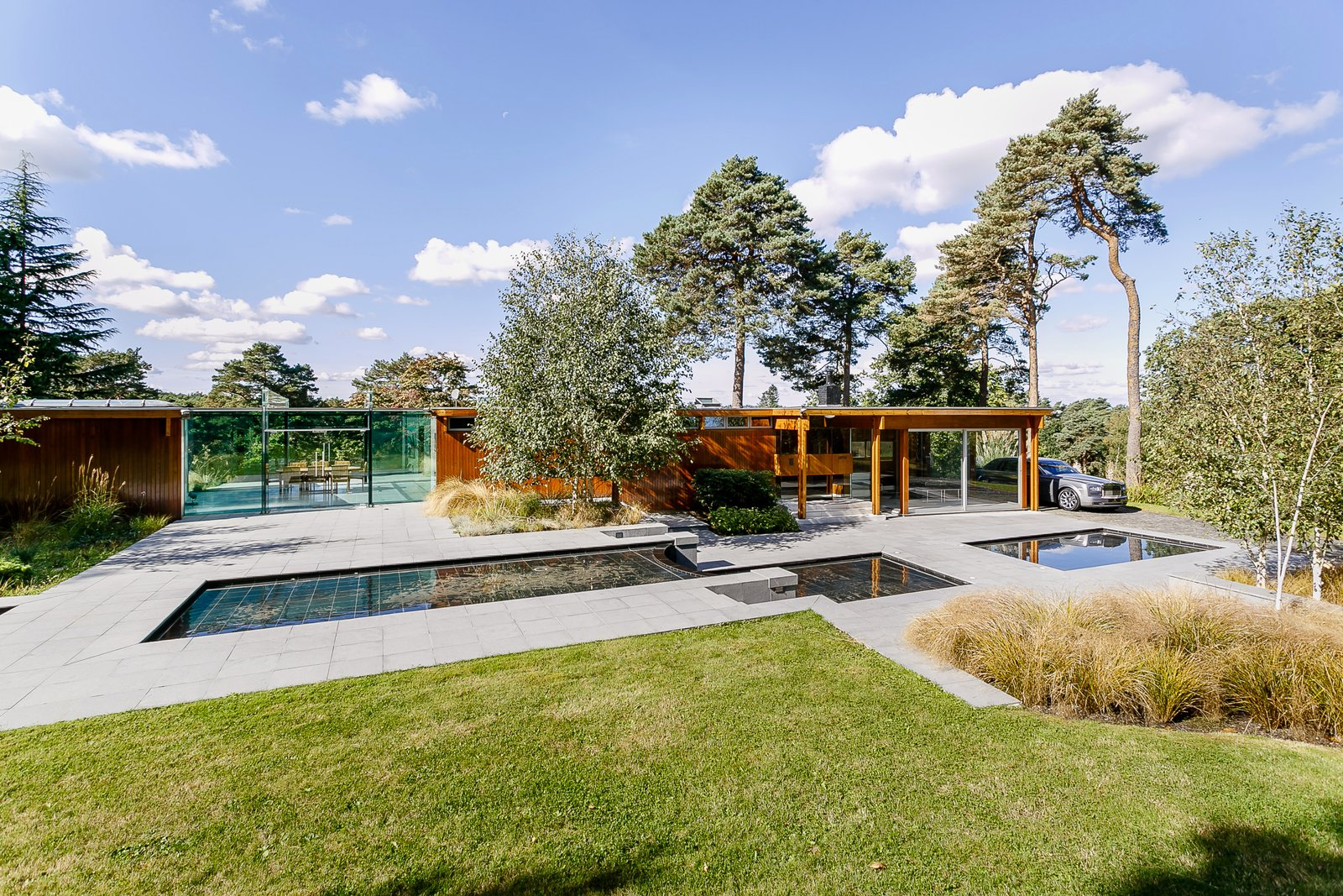 Tagged: Outdoor, Front Yard, Walkways, Large, Trees, Grass, and Pavers.  Best Outdoor Pavers Grass Photos from A Modernist Time Capsule by Erno Goldfinger Asks $4M