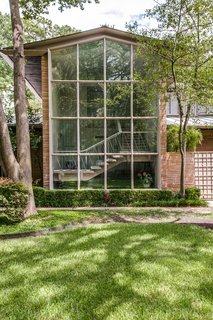 A Frank Lloyd Wright-Inspired Waterfront Masterpiece in Dallas Is Up For Auction - Photo 1 of 15 - Floor-to-ceiling windows provide ample natural light and look out onto the landscape.