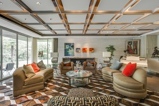 A Frank Lloyd Wright-Inspired Waterfront Masterpiece in Dallas Is Up For Auction - Photo 4 of 15 - The living room area features recessed lighting and terrazzo flooring with brass filings.
