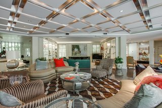 A Frank Lloyd Wright-Inspired Waterfront Masterpiece in Dallas Is Up For Auction - Photo 5 of 15 - Bright and airy, the living area is a large open-plan space designed for entertaining.