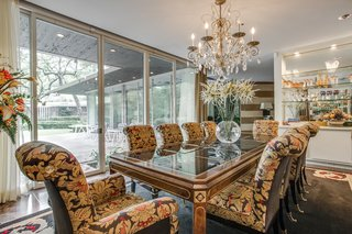 A Frank Lloyd Wright-Inspired Waterfront Masterpiece in Dallas Is Up For Auction - Photo 9 of 15 - A vast sense of space exists in the large formal dining room which overlooks the patio.
