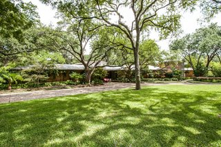 A Frank Lloyd Wright-Inspired Waterfront Masterpiece in Dallas Is Up For Auction - Photo 14 of 15 - Beautiful, organic landscape was designed naturally around the trees to overlook a nearby pond.