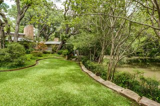A Frank Lloyd Wright-Inspired Waterfront Masterpiece in Dallas Is Up For Auction - Photo 15 of 15 - This Dallas gem is set against a dramatic backdrop and offers breathtaking views from every room.