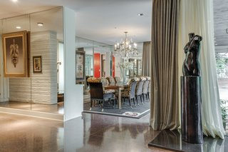 A Frank Lloyd Wright-Inspired Waterfront Masterpiece in Dallas Is Up For Auction - Photo 8 of 15 - The living area opens to the dining room area.