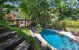 Anna Faris Lists Her Midcentury Abode in the Hollywood Hills For $2.5M - Photo 2 of 16 - The lagoon-like pool sparkles in the L.A. sun.