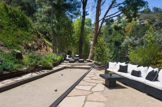 Anna Faris Lists Her Midcentury Abode in the Hollywood Hills For $2.5M - Photo 3 of 16 - A bocce court is perfect for al fresco entertaining.