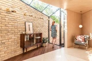"""A Crafty Triangular Addition Carves Out Office Space in a London Backyard - Photo 2 of 11 - The north-facing rear yard was located on the lower ground floor, and its uniquely challenging triangular shape lead to the project being referred to as the """"Triangle."""""""