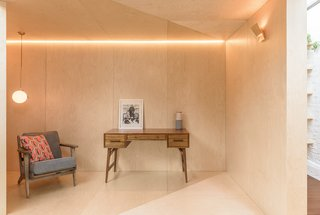 A Crafty Triangular Addition Carves Out Office Space in a London Backyard - Photo 5 of 11 - Every surface of the Triangle is clad in a high-quality birch plywood.