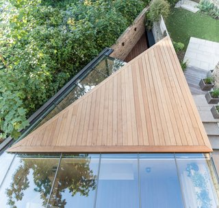 A Crafty Triangular Addition Carves Out Office Space in a London Backyard - Photo 1 of 11 - An overhead view of the triangular extension exposes its unique geometry.
