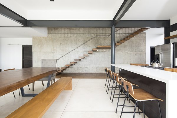 A floating staircase leads to the second level of the home.
