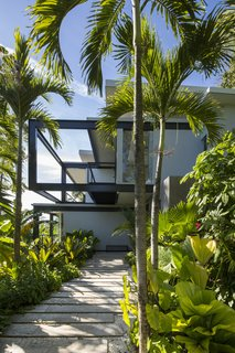 Slip Away to These Sleek New Villas in a Costa Rican Forest - Photo 3 of 23 - The approach to Casa Bri Bri