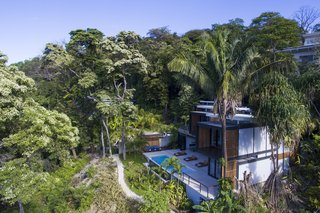 Slip Away to These Sleek New Villas in a Costa Rican Forest - Photo 12 of 23 - Casa Meleku nestled in the hillside