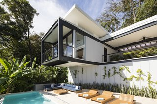 Slip Away to These Sleek New Villas in a Costa Rican Forest - Photo 4 of 23 - A peaceful poolside vignette at Casa Bri Bri