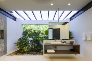 Slip Away to These Sleek New Villas in a Costa Rican Forest - Photo 11 of 23 - The bathroom integrates a sense of the outdoors.