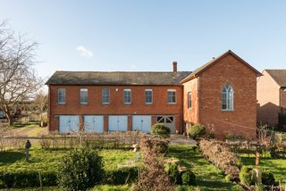 A Converted 19th-Century Church in the English Countryside Asks $923K - Photo 1 of 17 - The brick exterior of the main house