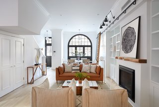Two Renovated Carriage Houses in Brooklyn Hit the Market - Photo 8 of 13 - Built-in shelving and a gas fireplace with a customized mantel by Fitzhugh Karol preside over 411 Vanderbilt's living room.