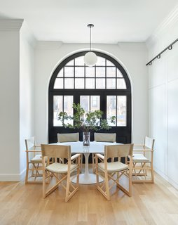 Two Renovated Carriage Houses in Brooklyn Hit the Market - Photo 7 of 13 - The original archway, through which horse-drawn carriages once entered, has been preserved and updated with custom glass-and steel-windows.