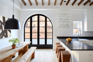 Two Renovated Carriage Houses in Brooklyn Hit the Market - Photo 9 of 13 - Ample natural light streams into the kitchen and dining area of 411 Vanderbilt via the landscaped backyard.