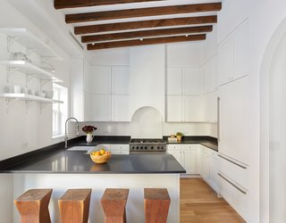 Two Renovated Carriage Houses in Brooklyn Hit the Market - Photo 10 of 13 - Adjacent to the kitchen, a powder room and laundry offer convenience.