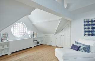 Two Renovated Carriage Houses in Brooklyn Hit the Market - Photo 12 of 13 - The third floor of 411 Vanderbilt features a fourth private bedroom with peaked ceilings, exposed beams, an ensuite bath and a round window.