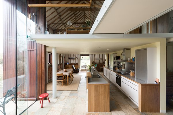 The full height glazing amplifies the airy sense of interior space.