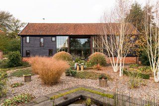 This Spectacular Suffolk Barn Conversion Hits the Market at $1.26M - Photo 2 of 13 - Additional glazing was added to the structure to increase the natural light.