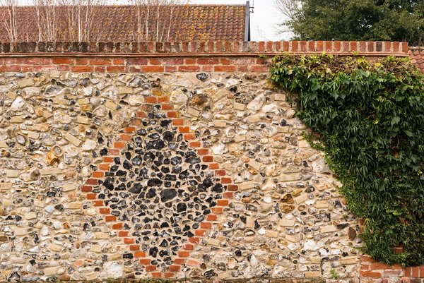 The exterior stone wall.