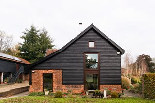 This Spectacular Suffolk Barn Conversion Hits the Market at $1.26M - Photo 13 of 13 - There are 21 solar panels on the roof of the former cart shed that sits behind the main house.