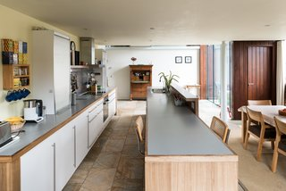 This Spectacular Suffolk Barn Conversion Hits the Market at $1.26M - Photo 8 of 13 - The open kitchen and dining area