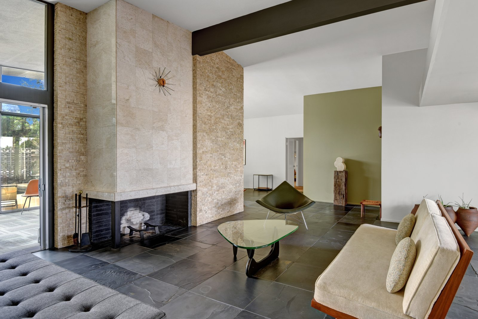 The split rock fireplace is just one of the pristine original midcentury details this home has to offer.
