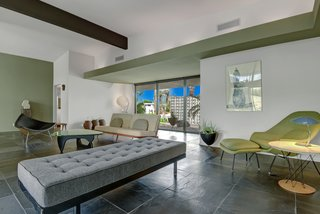 Devo Co-Founder Gerald Casale Lists His Palm Desert Midcentury For $1.2M - Photo 5 of 14 - The entire living, dining, and entry area features dark slate flooring.