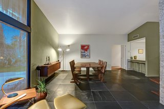 Devo Co-Founder Gerald Casale Lists His Palm Desert Midcentury For $1.2M - Photo 6 of 14 - The dining area is just off the kitchen and living area.