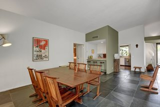 Devo Co-Founder Gerald Casale Lists His Palm Desert Midcentury For $1.2M - Photo 7 of 14 - The dining room view towards the kitchen
