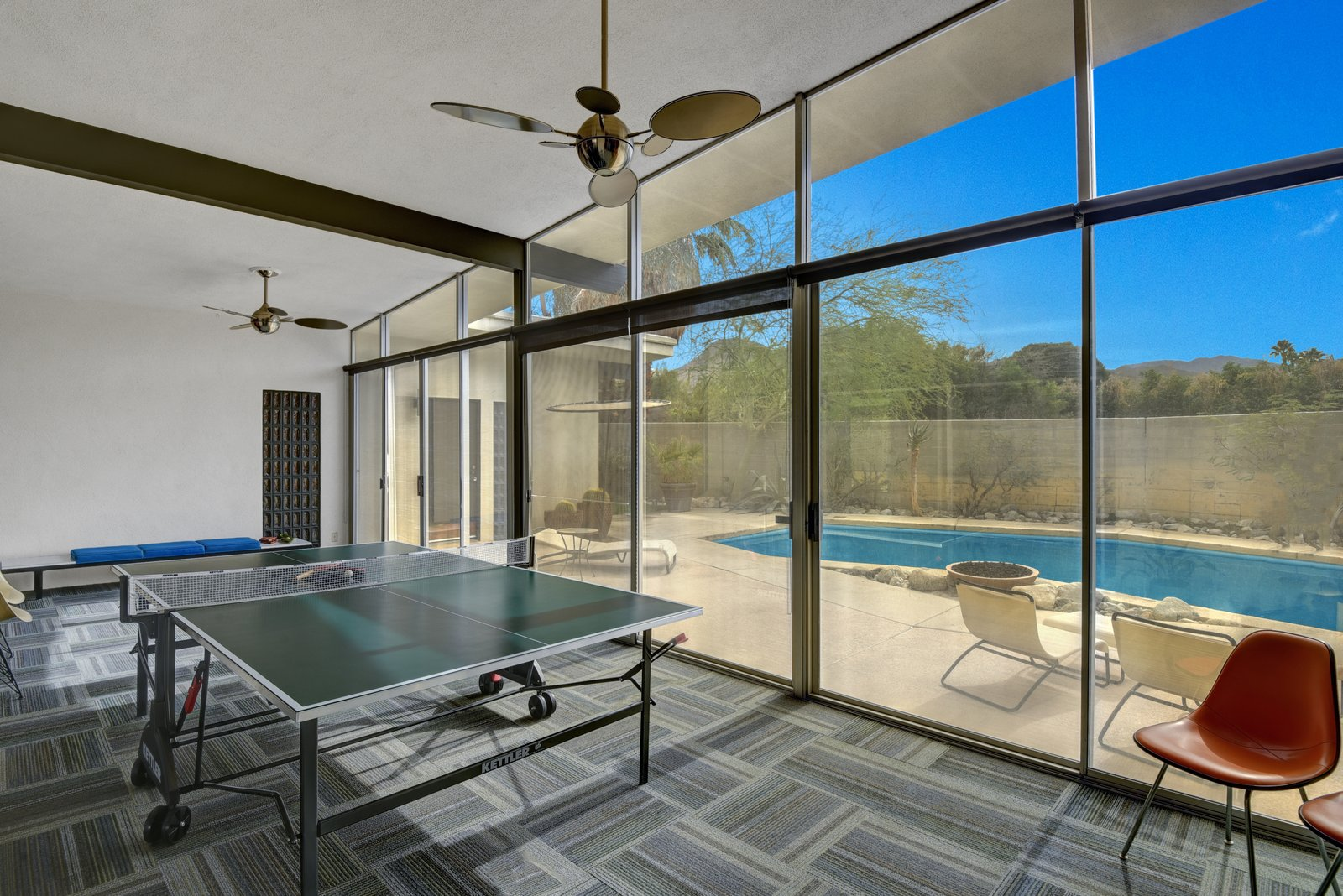 A bonus area overlooks the pool and is currently being used as a game room.