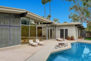 Devo Co-Founder Gerald Casale Lists His Palm Desert Midcentury For $1.2M - Photo 11 of 14 - The pool area showcases a Pebble-tec saltwater pool, fountain, succulent garden, and fire pit.