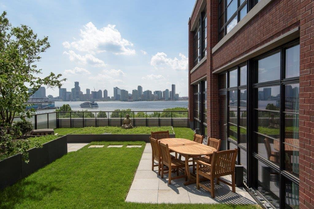 The apartment comes with a 1,500-square-foot landscaped terrace with stunning views of the city, along with two smaller patios (one off the master bedroom).