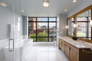 Jon Bon Jovi Sells His West Village Duplex For $16M - Photo 6 of 8 - The luxurious master bath has a double vanity, soaking tub, glass-enclosed stall shower, and a wall of windows.