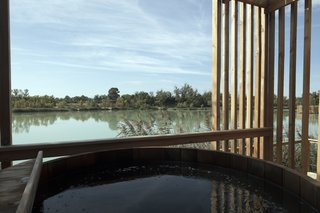 "Drift Off in a Prefab Cabin at This Floating Hotel in France - Photo 8 of 13 - A view from the jacuzzi of the ""spa"" suites"