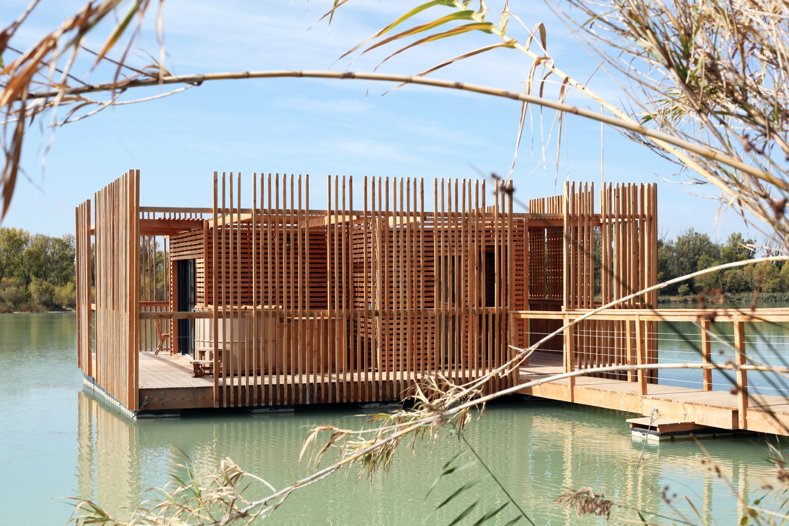 A view of the surrounding wraparound deck and wooden privacy screens.