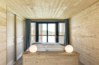 Drift Off in a Prefab Cabin at This Floating Hotel in France - Photo 9 of 13 - The minimalist interiors of the suites