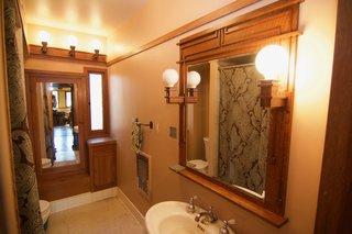 A Rare Lloyd Wright Prairie Home in L.A. Wants $1.35M - Photo 8 of 10 - Charming vintage original bathroom fixtures