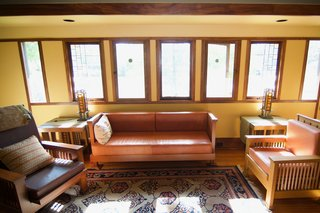 A Rare Lloyd Wright Prairie Home in L.A. Wants $1.35M - Photo 7 of 10 - Art glass windows preside over the living room.
